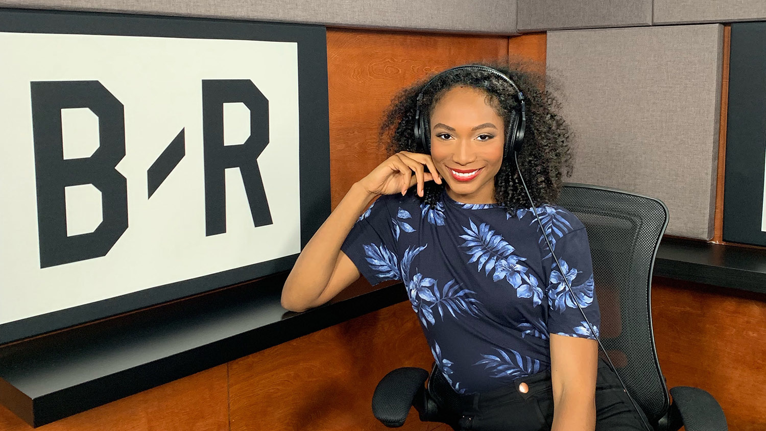 Arielle Chambers wearing a headset in a recording booth.