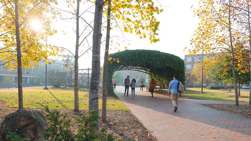 Students walk through archway