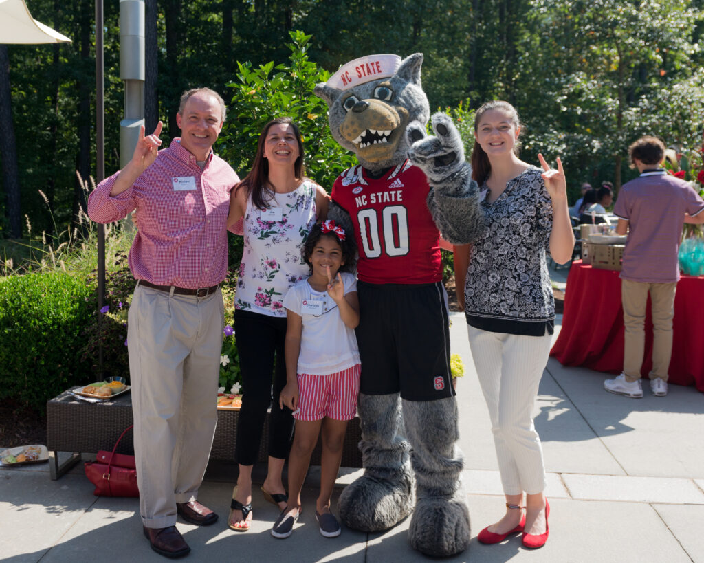 Family poses with Mr. Wuf during PFS weekend