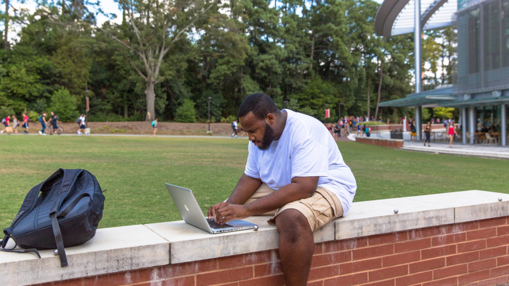 Student studying outside Talley